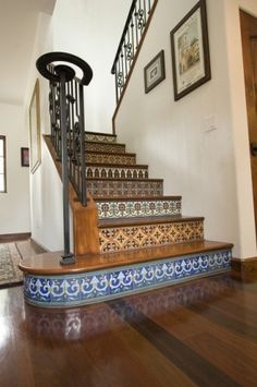 Spanish Colonial Elements: 4. Hand painted tiles on stair risers. These stair risers are covered with colorful Catalina style tiles, which combine glossy and matte finishes. This adds wonderful depth to the patterns.     Tip: When selecting patterned tiles for your stair risers, it is okay (and encouraged) to combine different patterns. Just make sure the colors work well together.