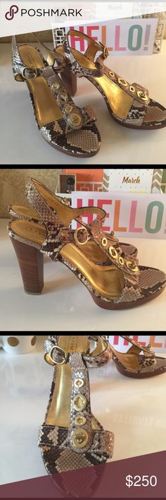 Coach Printed Python sandals size 9.5 One of a kind Coach snake skin brown and beige tones gold foot bed. 4 inch stacked heel. Always in style made in Italy originally $289.00. Size 9.5 but fit more like a 10. Make a reasonable offer. Coach Shoes Sandals