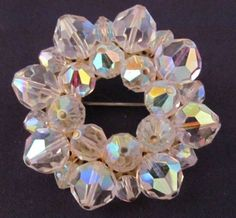 Faceted rhinestone clusters shimmer and sparkle in this chunky vintage brooch.