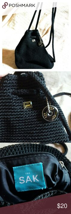 Vintage The Sak Backpack Purse Takes me back to the 90's! Great condition and perfect for summer activities. Other then a few light scratches on the keychain, it is basically new! The Sak Bags