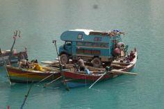 Truck crossing River in a Boat
