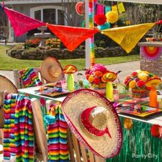 Create a south-of-the-border setting for your fiesta! Invite your amigos over to fiesta like there's no mañana! Set the scene for fun by stringing up a colorful bandana bunting over a table styled with sombreros, serapes and Mexcian soda bottles.