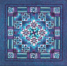 Mystical Prism Quilt designed by Wing and a Prayer features Mystical Batiks from Timeless Treasures
