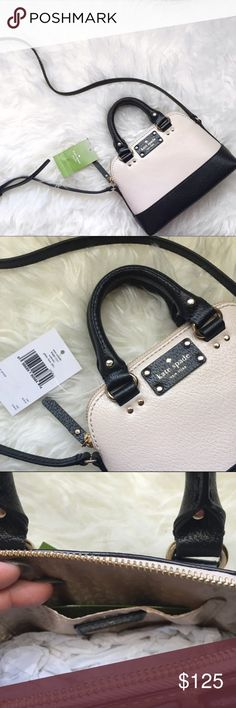 "4th OF JULY SALE!  Kate spade mini Rachelle♠️  gorgeous Kate spade mini Rachelle in a Black and cream color. Super cute and fun as a summer bag!  with tags. Length: top 6"" bottom 8"", depth: 2.5"", height: 6"", handles: 6"", strap: 17""-23"" adjustable. No trades and no PayPal. kate spade Bags Mini Bags"