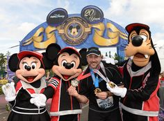 Joey Fatone celebrating the completion of the Goofy and a Half Challenge at the 20th Anniversary Walt Disney World Marathon