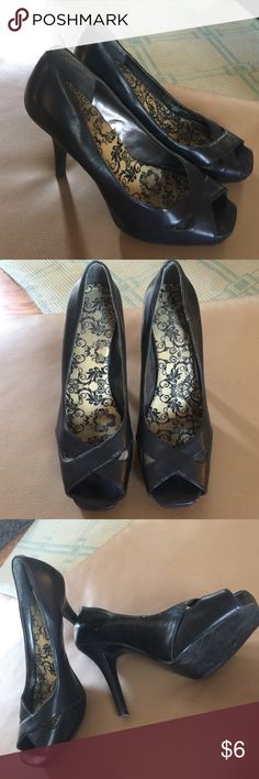 """Peep toe heels. Sharp pair of heels. Attached comfort insole. Minimal wear. Are a tight size 7.  Full 4"""" spike heel. Shoes Heels"""