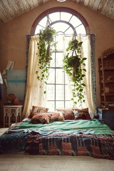 I just love this fun bohemian bedroom décor! I love the bed on the floor, with all of the patterns and textiles and of course all of the hanging plants.