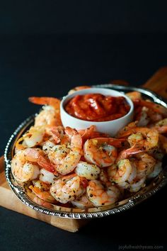 Easy 10 Minute Garlic Herb Roasted Shrimp served with a homemade Cocktail Sauce. These Roasted Shrimp are the ultimate Holiday Party Appetizer! So put that flavorless cocktail shrimp down and make… Shrimp Recipes, Fish Recipes, Gourmet Recipes, Cooking Recipes, Healthy Recipes, Party Recipes, Herb Recipes, Skinny Recipes, Drink Recipes