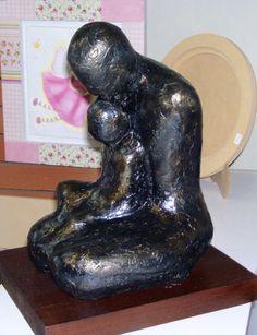 Patina sobre ziña, escultura Padre e hijo. Taller de Jeannette Molina