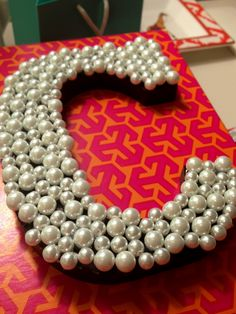 C for Cheryl,  entailed  with pearls~