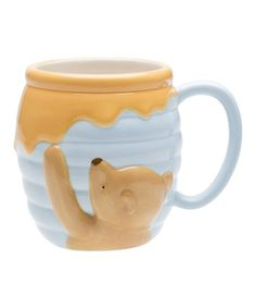 Enjoy a cup of something warm on break or with a good book using this Winnie the Pooh mug. Featuring classic Pooh on his never-ending honey hunts, it's a charming addition to any collection.