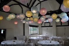 Pastel paper lantern canopy at Nether Winchendon House Carriage Barn - perfect for soft lighting with a clever colour change option for the dancing later Cheap Wedding Lighting, Backyard Wedding Lighting, Hanging Lanterns, Paper Lanterns, Ceiling Decor, Ceiling Lights, Diy Outdoor Weddings, Event Lighting, House Lighting