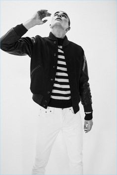 Diego Villarreal sports a leather sleeve bomber jacket, striped sweater, and jeans from RRL.