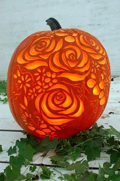 Beautiful inspiration for your Halloween pumpkin carving in this artful gallery of carved pumpkins