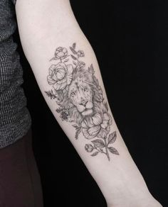 extremely detail lion tattoo with surrounding peonies and rose, black and white with forearm placement, pin: morganxwinter