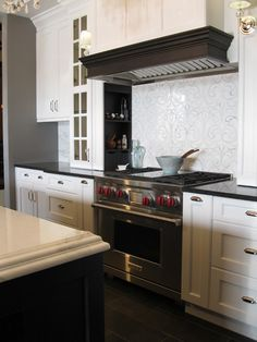 Designer Jane Kelly, Airoom LLC    Detail This kitchen features an elegant Danse Blanc backplash, from the Chateau collection.