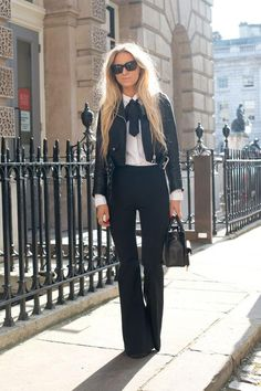 A leather jacket and pussy bow blouse? Yes, please! See 19 other street style outfits we love