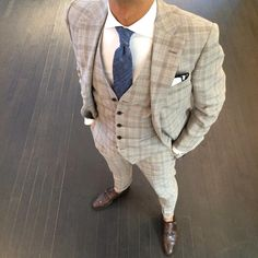 sand colored glen plaid three piece suit. crisp. white oxford. brown double monk strap brogues. blue knit tie. white pocket square w/ navy blue piping. corner office. killin' it. my. style.