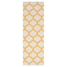 """Artfully hand-woven in India, this beautiful wool rug evokes exotic style with a quatrefoil trellis motif.    Product: RugConstruction Material: WoolColor: Ivory and golden yellowFeatures:  Hand-wovenReversibleMade in India Dimensions: 2'6"""" x 8'Note: Please be aware that actual colors may vary from those shown on your screen. Accent rugs may also not show the entire pattern that the corresponding area rugs have.Cleaning and Care: Vacuum regularly with non-beater attachment. Blot stains…"""