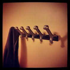 Connecting rod coat rack