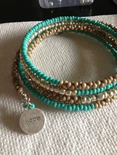 Turquoise, Silver and Tan Seed Beads on Memory Wire with charm