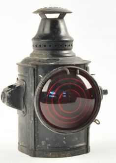 """Small size marker lamp for railroad handcar with one 4"""" dia. red lens and mounting posts one either side of the lamp. Marked ADLAKE on top and with pot and burner inside. size: 9.5"""" t."""