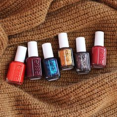 Be stylish with these essie fall nail polish shades for fashionable sweater weather days. Try an alloyed bronze metallic 'leggy legend', heat things up with a burgundy 'with the band', brighten things up with an orange red 'color binge', be exotic with a cinnamon plum 'in the lobby', shine with a midnight indigo 'bell-bottom blues', and shimmer with this espresso 'frock 'n roll' shade from the essie fall 2015 collection.