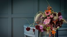 Contact - Jay Archer Floral Design Basingstoke based florist that uses wild flower, might be expensive, worth a look
