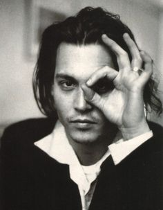 "Johnny Depp throwing up the ""3"" goggles. He must be a Cat fan. :)"