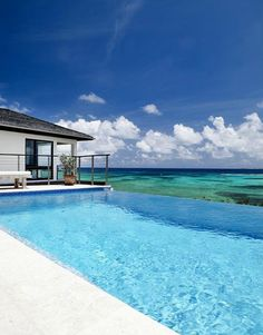 Ocean Blue Clear Skies- would love to have a beach house with a pool facing the ocean