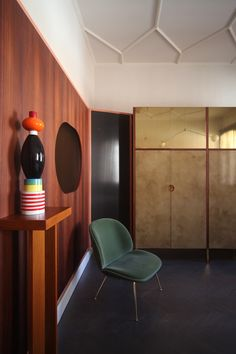 Beetle armchairs by Gubi, totem by Sottsass from Arts & Crafts Gallery, Venice, mirrors by Atipico,