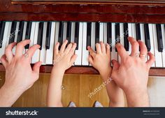 stock-photo-top-view-close-up-of-hands-of-father-and-child-on-a-piano-keyboard-the-parent-teaches-the-kid-to-441950350.jpg (1500×1080)