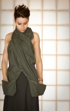 Scarf with snaps and pockets, can also be a woman's jacket.