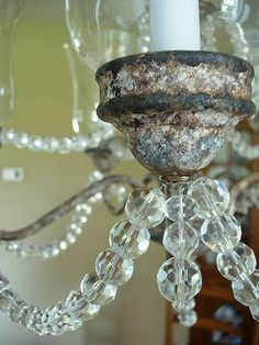 Don't throw away that brass chandelier! You can have a gorgeous DIY crystal chandelier with a quick coat of paint and crystals!