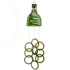 """It's wine o'clock (somewhere!) — which means it's time to share a wine-related repurposing find: Wind chimes made from wine bottles. (via LoraLinn on Etsy) For earlier finds, check out Unconsumption's """"wine o'clock"""" series of posts here. Wine Bottle Corks, Wine Bottle Crafts, Bottles And Jars, Glass Bottles, Bottle Slumping, Glass Wind Chimes, Bottle Cutting, Cork Crafts, Beer Crafts"""