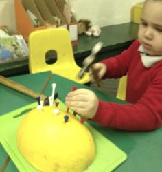 Melons and golf tees - make a dragon! Pattern making, gross motor skills, counting and using number
