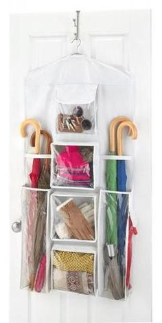 "Hanging Gift Wrap Organizer Dimensions: 23.25""W x 0.1""D x 46.75""H Weight: 1.7 pounds Material: Polypropylene Color: White / Clear Fabric Body with Multiple Clear Pockets Protects Tubes of Wrapping Pap"