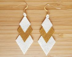 Items similar to Earrings black gold Gaia and woven Miyuki glass beads on Etsy Bead Jewellery, Seed Bead Jewelry, Seed Bead Earrings, Beaded Jewelry, Beaded Earrings Patterns, Beading Patterns, Peyote Triangle, Gold Glass, Bead Earrings