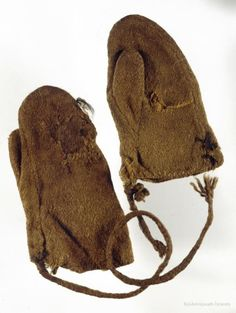 """Child's mittens, sewn from vaðmál, fastened together with a woollen cord, 10th or 11th century."" From Heynes in Akranes, Borgarfjarðarsýsla. Þjóðminjasafn Íslands."