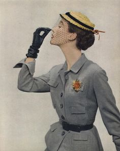 Yellow and Grey: 1950s Yellow hat with netting and grey suit, black belt, and black gloves