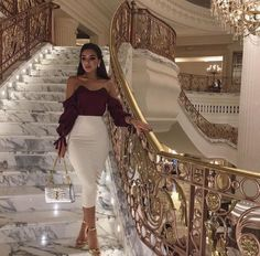For any wondering, I'm looking at the Gorgeous stairs and railing behind the girl