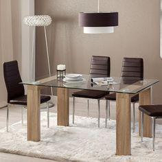 Mesa Alma. Mesa de comedor de diseño minimalista con tapa es de cristal transparente de de 8 mm. de grosor y estructura de dos patas metálicas acabado color roble. Outlet Hogar Mallorca