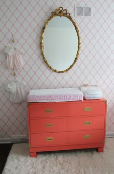 Antique Campaign Dresser Painted Coral - love the vintage dresser and mirror paired with the modern accent wall!