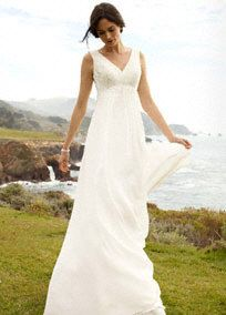 Breathtakingly beautiful, this exceptional illusion back sheath wedding dress is flawless.   Organic and soft in styling, this soft Chiffon is perfect for an outdoor affair.  Illusion back gives additional coverage while remaining soft and feminine.  Lightweight Chiffon fabric is the ultimate in providing an easy, effortless look.  Sweep Train. Sizes 0-14. Available in Ivory or White in select stores and by special order.  Woman: Style 9WG3429  Sizes 16W-26W (special order only)  Fully…