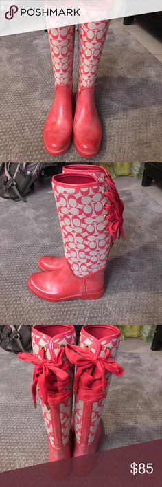 Coach coral rain boots ☔️👢 These coach rain boots are beautiful and stylish! Size 8 in women's. Cross cross tie in back. Coach Shoes Winter & Rain Boots