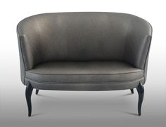 DELICE Sofa by Koket | This exquisite confection embraces you with its heavenly curves & luscious accents. This upholstered delicacy is accented by ever so sweet black lacquered feet. #sofa #upholstery #livingroom http://www.bykoket.com/guilty-pleasures/upholstery/delice-sofa.php