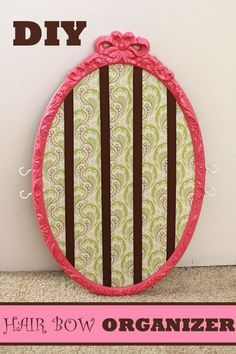 DIY: Hair bow organizer for girls room.  Use old frame, fabric, ribbon, and a few hooks.