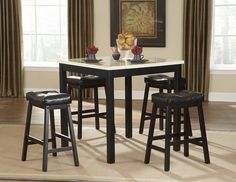 Archstone Collection Counter Height 5 Pc Dinning Table Set(Table, 4 Stool) $288 The white faux marble top pairs perfectly with comfortable saddle back stools, the color contrast and stylish design create a rich visual enhancement. Available in 5-piece pack counter height set.Finish:BLACK finishDimensions:Table:36 x 36 x 36HStool:20 X 13.5 X 26HServer also available.