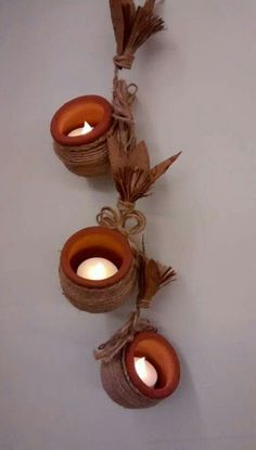 Simple diya decoration ideas for Diwali Browse beautiful diya images online on HappyShappy! Also find and save decorative diyas design photos for competition in school. Diya Decoration Ideas, Diwali Decorations At Home, Decor Ideas, Coconut Decoration, Diy Home Crafts, Diy Arts And Crafts, Hanging Pots, Hanging Lamps, Hanging Lights