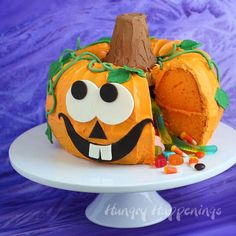 Cut into this festive Pumpkin Pinata Cake to reveal candy hiding inside. This Halloween dessert will really wow your Halloween party guests.